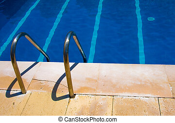 Detail of a swimming pool blue water in summer time
