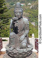 """Bodhisattva sculpture near """"Big Buddha"""" in Hong Kong"""