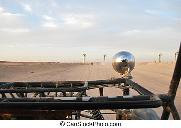 buggy car in desert, sand and sky