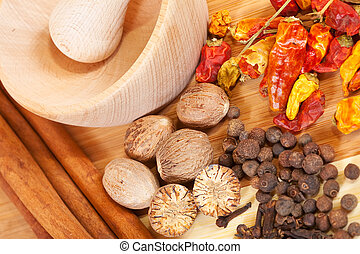 various natural spiciness with pestle and mortar over wooden...