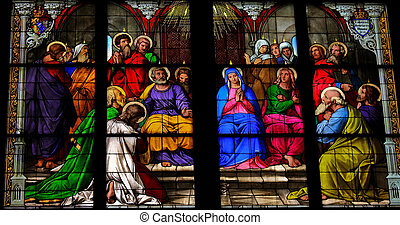 Pentecost - Stained glass church window depicting Pentecost...