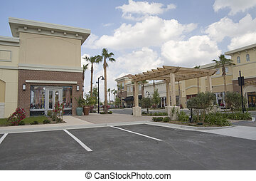 tropical strip mall - upscale shopping mall with tropical...