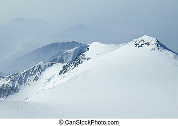 Snowy Peaks in Denali Wilderness Preserve - Snow covered...