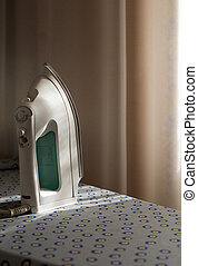 electric iron - white electric iron on the ironing board