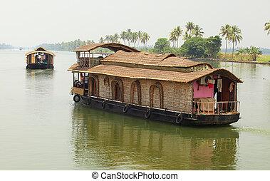 Houseboat on Kerala Backwaters - A houseboat plying the...