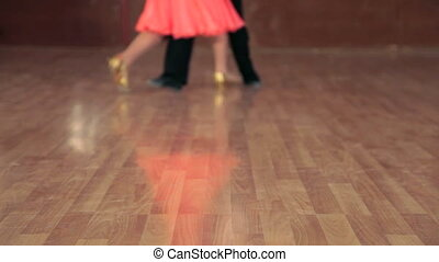 young dancers feet waltzing in ballroom, DOF