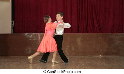 dancing couple - boy and girl dancing the waltz in the...