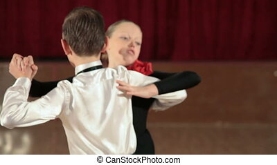 Couple Tango Dancing - boy and girl dancing the Tango in the...