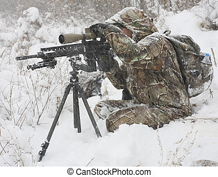 Winter shot - Hunter that is trying to sight in during a...