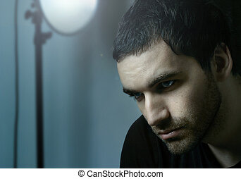 Dramatic Portrait - Dramatic shadowy portrait of young...