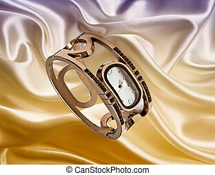 Fashion watch isolated on silk background