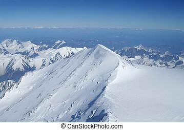 Summit to Horizon in Denali Wilderness - Snow covered...