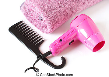 Toiletry in pink - Pink towel, hair-drier and black comb on...