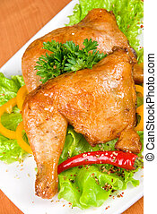 roasted chicken ham garnished with fresh green salad, pepper...