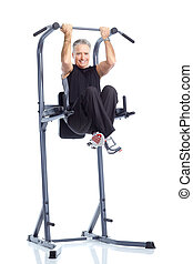 Gym and Fitness - Gym Fitness Smiling elderly man working...