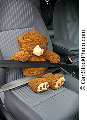 Safety Seat - Teddy with seat belt in a car