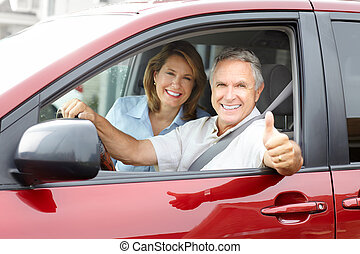 Senior couple in the car - Smiling happy senior couple in...