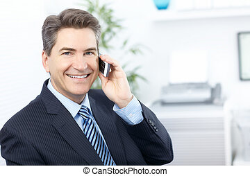 Businessman - Handsome smiling business man calling by...