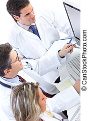 Medical doctors - Smiling medical doctors working with a...