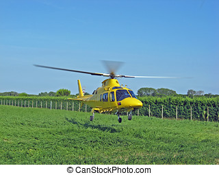 yellow rescue helicopter air ambulance takes off during an...