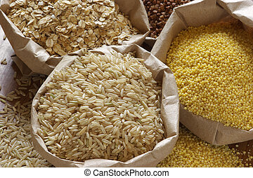 Various cereals in bags - Brown rice, oatmeal, millet and...