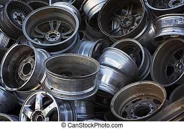 Car Rims Ready for Recycling - A large, sorted pile of car...