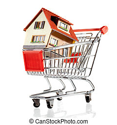 House and shopping cart - House in shopping cart on a white...