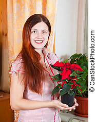 Girl with Christmas Star flowers
