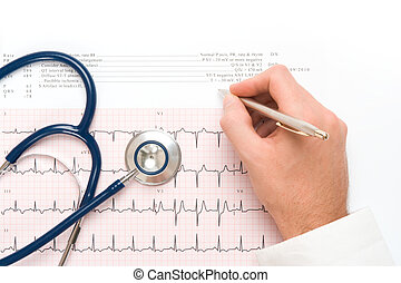 Medical concept - Doctor write note on electrocardiogram ECG...