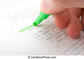Programmer analyst check printed code with highlighter