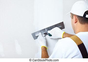 Contractor plasterer - Mature contractor plasterer working...
