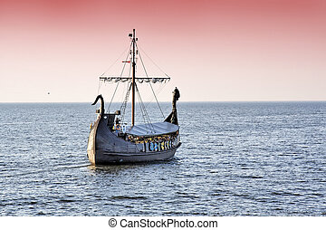 Ship of Viking's. - Sunset background with sailing ship.