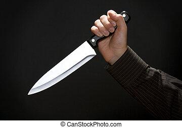 Killer - Man hold knife - black background