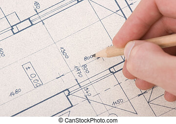 Architect with blueprint - Architect drawing his project of...