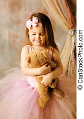 Little ballerina beauty hugging teddy bear - Adorable little...