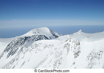Above Denali Peaks - Snow covered mountain peaks of Alaska...