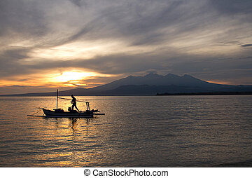 Sunrise above volcano Rinjani with fishing boat, Lombok