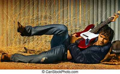 Man and Guitar - Horizontal full body portrait of hot young...