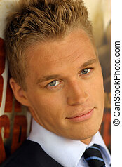 Young Blonde Guy - Close-up portrait of young male model in...