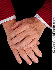 Arthritic Hands - Arthritic hands of a senior woman on a...
