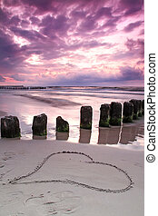 Calm sunset with symbol of love