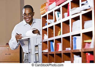 African American businessman reading document