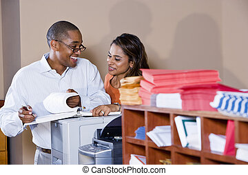 Multiracial office workers working on documents