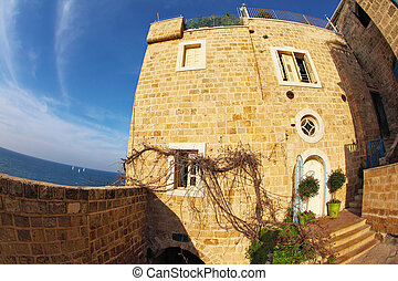 The ancient stone house in Old Yaffo. Warm day in December