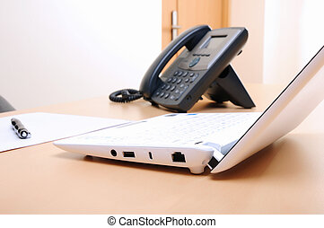 Workplace business person in the office. Phone and computer.