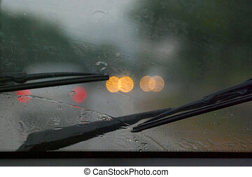 Rain - Road in rain through wind-screen of moving car