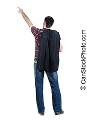young man pointing at wall. Rear view. Isolated over white...