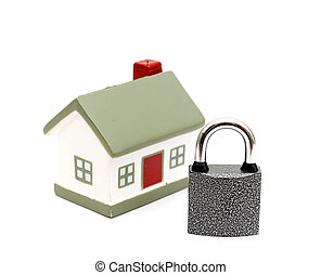 miniature house with lock isolated on white