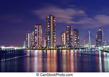 colorful night - Tokyo skyline by night in modern Tsukishima...