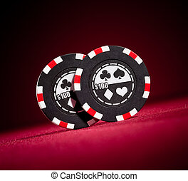 Casino gambling chips on the red